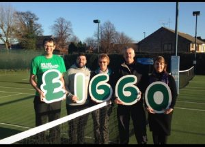 Cheque for £1,660 presented to Macmillan